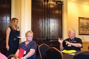 Larry Dodson (right), an Oldham County school board member and a member of KSBA's board of directors, interacts with Shannon Robinson (left), KSBA's training and conference coordinator during a Summer Leadership Institute clinic session.