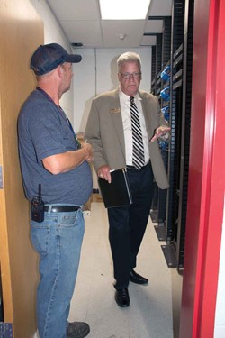 School safety assessment team member Chuck Fleischer (right) evaluates an equipment storage area at Nelson County High School with daytime custodian David Coulter. Fleischer is the retired Jefferson Co. Schools safety and environmental services director.