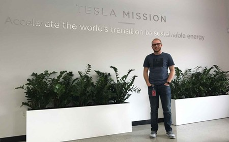 Estill County High School alumnus Kevin Haney in the Tesla Inc. offices in San Francisco, where he is a team member on the technology help desk. (Photo submitted)