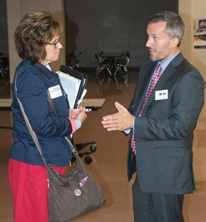 KSBA Governmental Relations Director Eric Kennedy (right) talks to State Rep. Melinda Gibbons Prunty at the Fall Regional Meeting in Webster County.