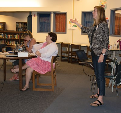 Frankfort Independent Schools social worker Marci Fritts explains to district staff during a summer training how they can use trauma-informed care in the classroom and school building.