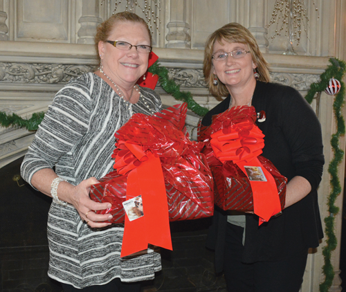 Katrina Kinman (left), KSBA's director of policy and eMeeting, and Kim Barker-Burton, KSBA senior policy consultant, were recognized for 10-year service milestones during the association's annual holiday gathering.